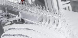 Conveyor line handling capsules